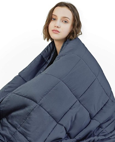 Girl Wearing a Weighted Blanket